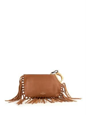 Lion-handle fringed leather clutch