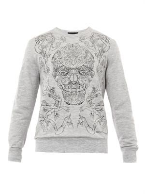 Hand and skull-embroidered sweatshirt