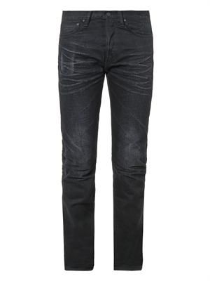 Slim black tapered-leg jeans