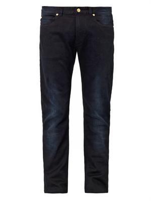 Medusa-embellished skinny jeans