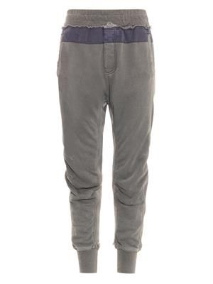 Distressed cotton-jersey track pants