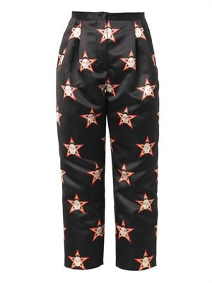 Faces and stars-print satin trousers