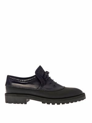 Bi-colour rubber and leather shoes