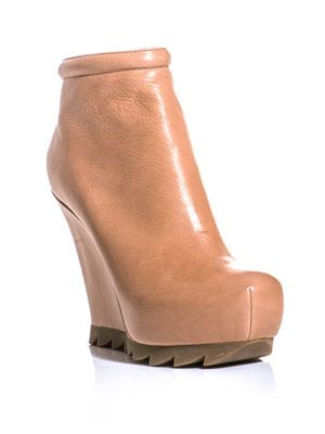 Saw-sole wedge boots