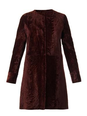 Reversible astrakhan fur coat