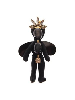 Winged doll brooch