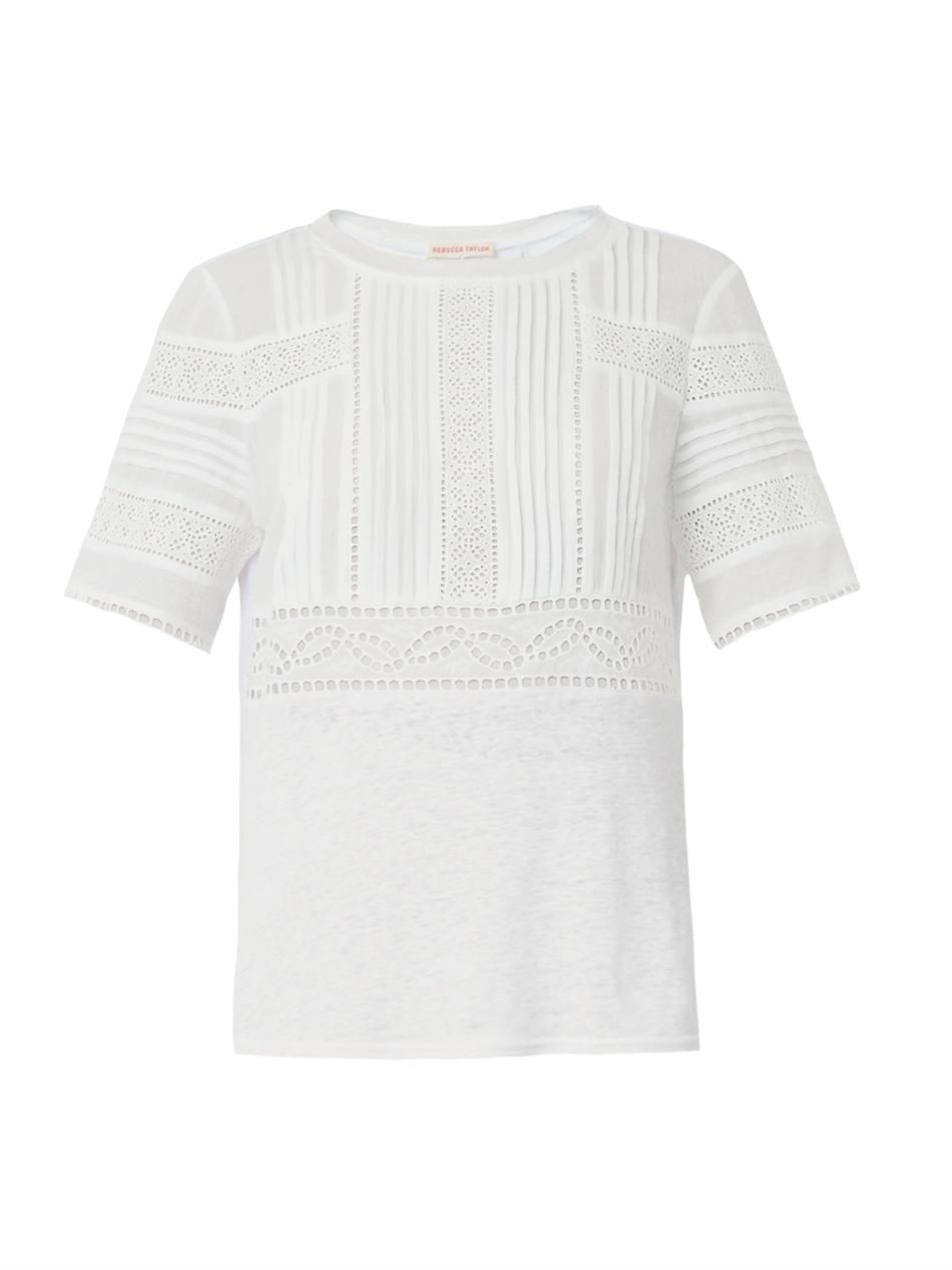 A pretty white t-shirt with a lovely Broderie Anglaise trim to the front yoke. Below the front yoke, the fabric is slightly gathered, giving a cool,comfortable fit. There is a slight discolouration on.